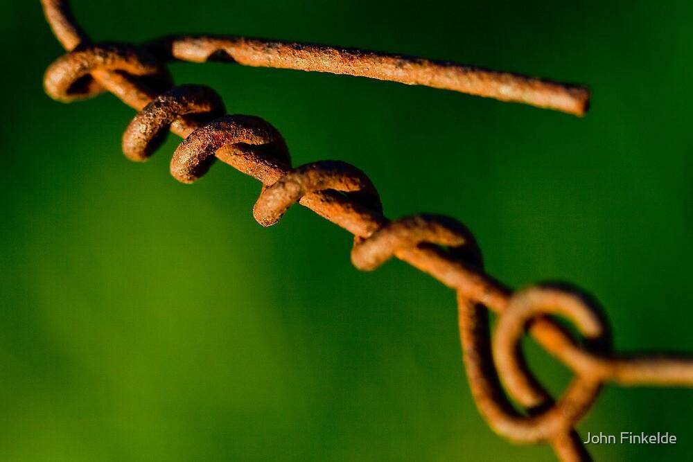 Rusty wire by John Finkelde