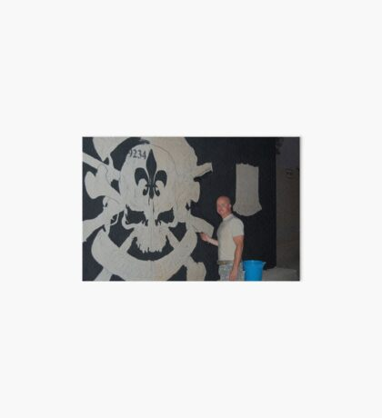 Josh King painting T-wall in Balad Iraq Art Board Print