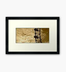 Among the clouds-timeless Framed Print