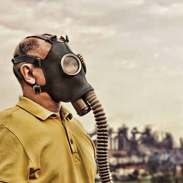 Man wearing gas mask standing against of industrial factory. by IaroslavB
