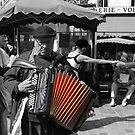 Street musician (Paris, France) by Christine Oakley