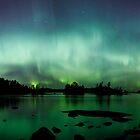 Beautiful northern lights over lake panorama by Juhani Viitanen