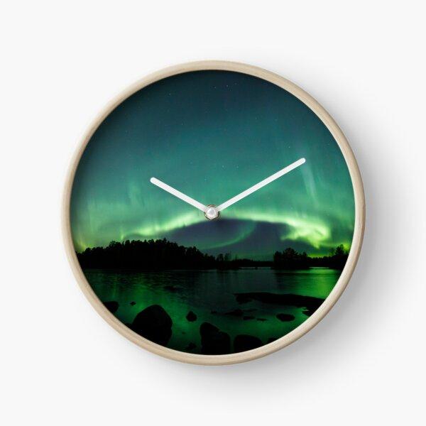 Beautiful northern lights over lake Clock