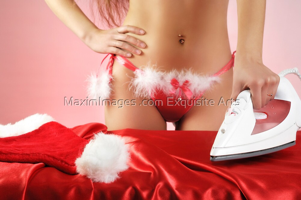 Sexy young woman getting ready for Christmas by ArtNudePhotos
