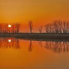 Reflections at sunrise by Adri  Padmos