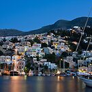 Symi island (Greece, Dodecanese) harbor at dusk by Yannis Larios