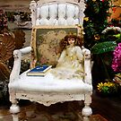 Christmas Doll On Chair by Larry Costales