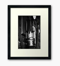 An Old Light in Darkness Framed Print