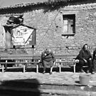 Laureana Cilento: bench with old women by Giuseppe Cocco