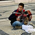 Lisbon, Portugal, young busker and tiny helper by BronReid