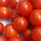 red tomatoes by fabio piretti