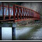 Bridge over river by Brett Wall