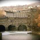 Pulteney Bridge crossing the river Avon in Bath, England by Kent Burton