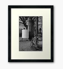 Bicycle and urinal Framed Print