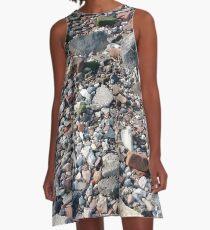 #rubble #pebble #scrap #stone #garbage #gravel #many #dust #litter #environment #pollution #broken #vertical #rockobject #stack #heap #textile #abundance #destruction A-Line Dress