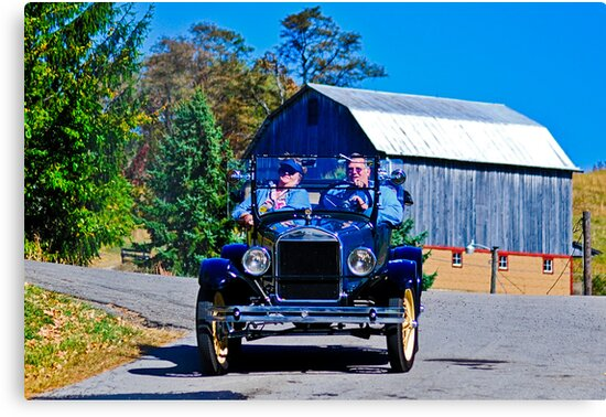 Blue Ford with Yellow Wheels by Bryan D. Spellman