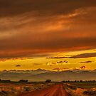 Sunset In Gold And Red by Gregory J Summers