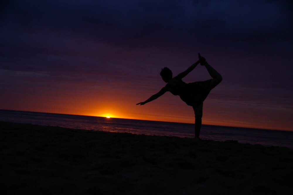 doing yoga at sunset down at the beach  by shawty