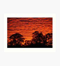 Sun set over a city suburb Art Print