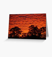 Sun set over a city suburb Greeting Card