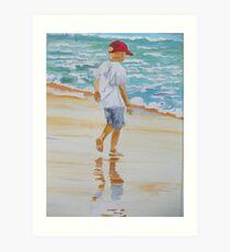 Boy on the beach red cap Art Print