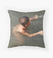 Boy swimming in the river Throw Pillow