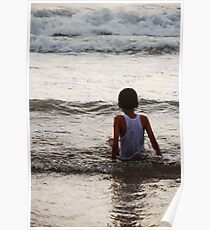 Boy watching the waves roll in Poster