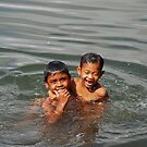 Balinese boys playing in the river by Michael Brewer