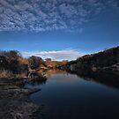 Last light hitting quarry pond by Richard Horsfield