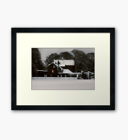 THE HOUSE IN THE SNOW II Framed Print