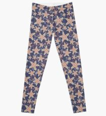 Seastar starfish pattern. Coral brown light blue sea stars on a dark blue background Leggings