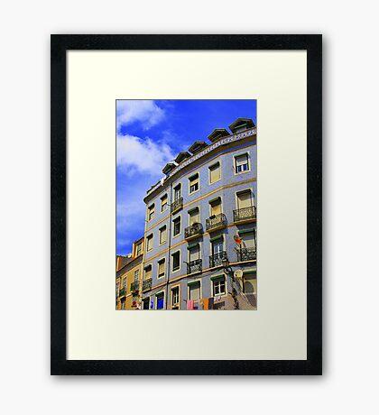 Lisbon window watching Framed Print