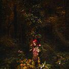 A girl. In Bodypaint. In a Tree. by Noel Taylor