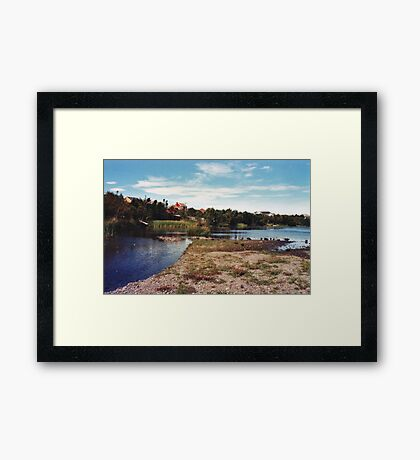 Behind the Houses and the Road Framed Print
