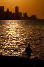 Havana Sunset & lone figure, Cuba  by David Carton