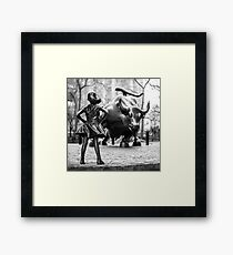 Fearless Girl statue facing Charging Bull in New York City | Black and White Framed Print