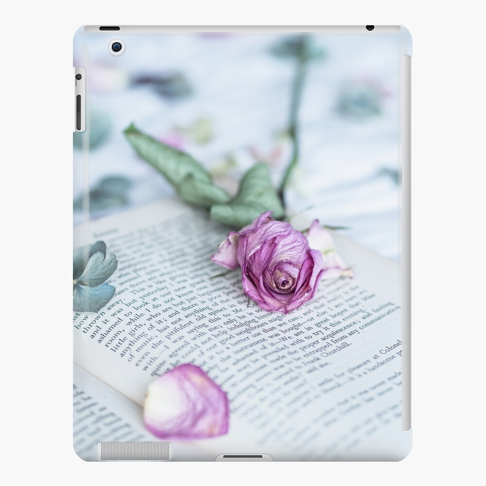 Still Life of Fading Rose on Book iPad Case & Skin