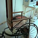 Old Wheel Chair at Palo Pinto Historical Museum by Susan Russell