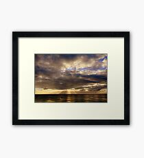 Sun rays over water Framed Print