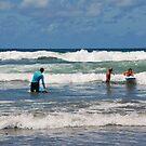 Surf lessons at Kuta Beach by Adri  Padmos