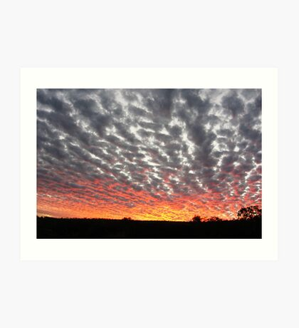 Sunset colours reflect onto the clouds Art Print