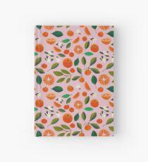 Cuaderno de tapa dura naranjada