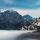 Sea of fog and snowy mountains by Patrik Lovrin