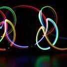 Symmetrical Rainbow light trails  by MovingInColor