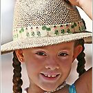 A girl with a hat by Larissa Brea