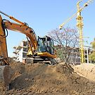 excavator on construction site industry by goceris