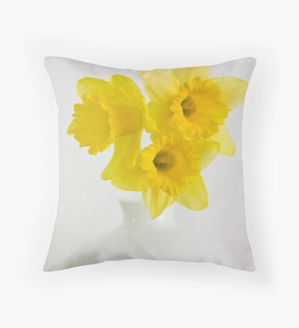 A vase of golden daffodils Throw Pillow
