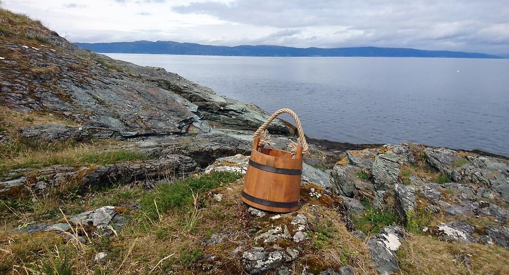 Bucket on the sea shore by svehex