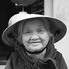Flower Lady - Hoi An, Vietnam by Odalisque