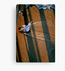 Skimboarder at sunset Canvas Print